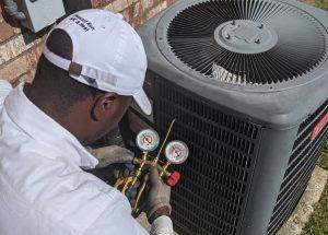 Forrest checks refrigerant levels on an Air Conditioner near Dallas, TX